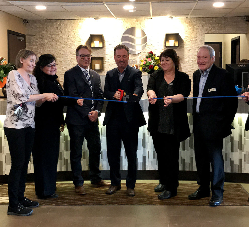 From left, Monica Kallis, Medicine Hat Comfort Inn and Suites Guest Services Manager, Irlanda Price, Community Connections chair with the Medicine Hat Chamber of Commerce, local MLA Drew Barnes, Medicine Hat Mayor Ted Clugston, Comfort Inn and Suites General Manager Carrie Bruce, Lloyd Daser, Director of Operations with the Braemar Group. Mayor Ted Clugston cut the ribbon with a saw to re-launch the Comfort Inn and Suites Medicine Hat hotel after its recent renovations.